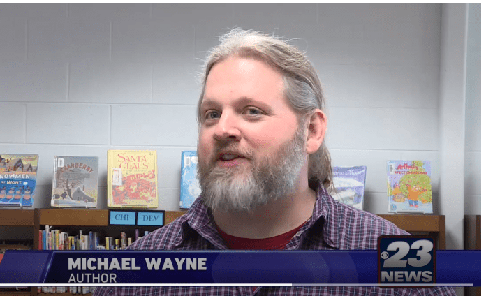 MICHAEL WAYNE ON TV NEWS